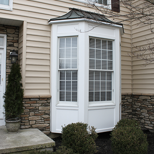 White window trims contrasting new James Hardie Siding on this Bucks County home